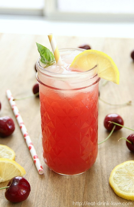 Cherry Vodka Spritzer in a glass jar with cherries and a straw