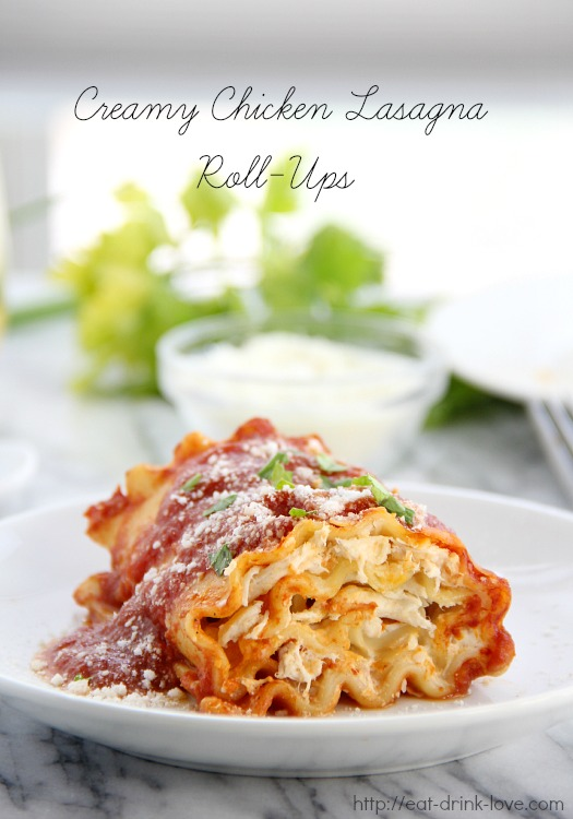 Creamy Chicken Lasagna Roll-Ups on a plate with tomato sauce on top