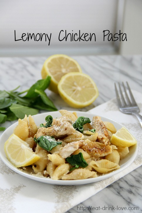 Lemony Chicken Pasta on a white plate with lemon slices