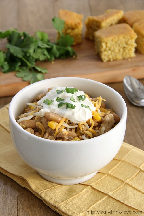 White Bean and Chicken Chili with sour cream on top