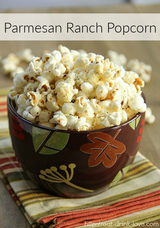 Parmesan Ranch Popcorn in a brown bowl with a striped napkin