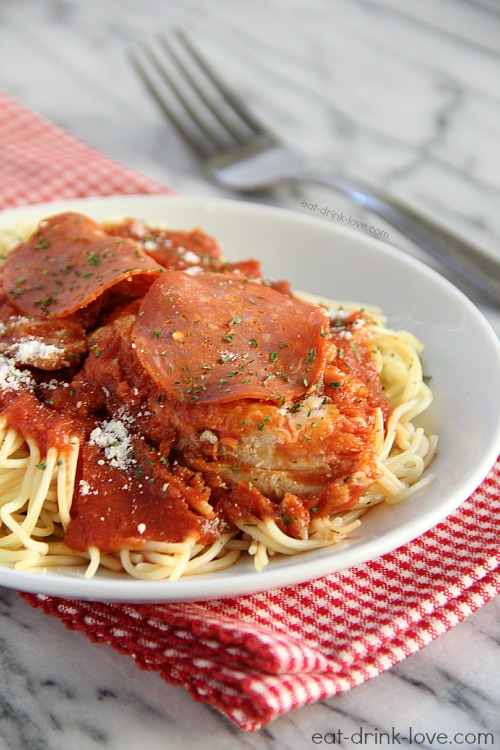 Chicken Pepperoni-Marinara on a plate with sauce and cheese