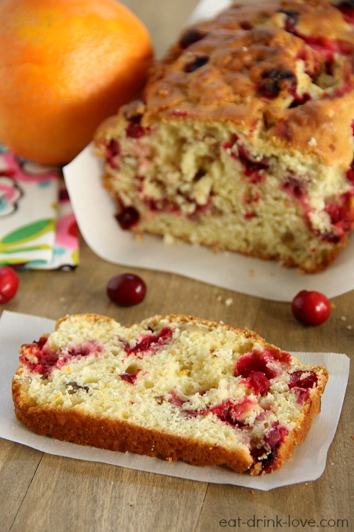 Cranberry Orange Bread sliced on a wood board