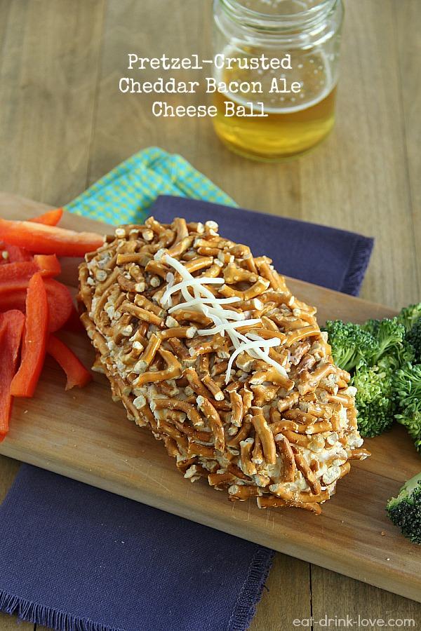 Pretzel-Crusted Cheddar Bacon Ale Cheese Ball with fresh veggies