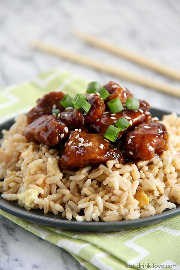 Lightened Up General Tso's Chicken on a plate with a green napkin