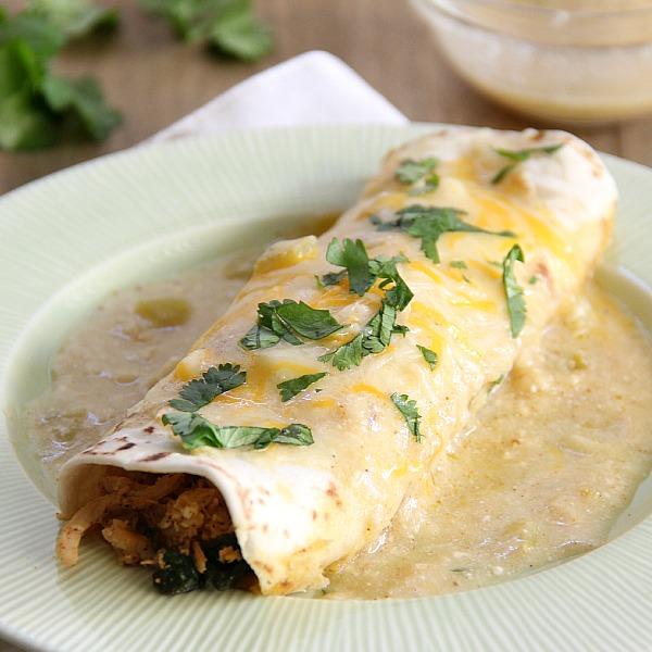 White Chicken and Spinach Enchiladas on a green plate