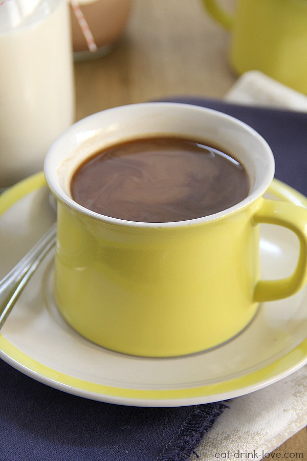 coffee in a yellow cup with homemade coffee creamer