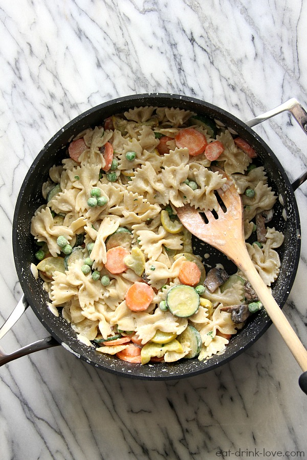 Low-Fat Pasta Primavera in a pan with a wooden spoon
