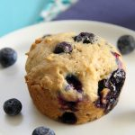 Skinny Blueberry Muffins on a plate with purple and blue napkins