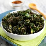 Zesty Baked Kale Chips in a bowl with green napkin