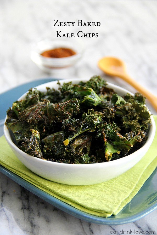 Zesty Baked Kale Chips in a white bowl with a green napkin