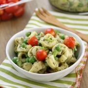 Pesto Tortellini Salad in a bowl with cherry tomatoes