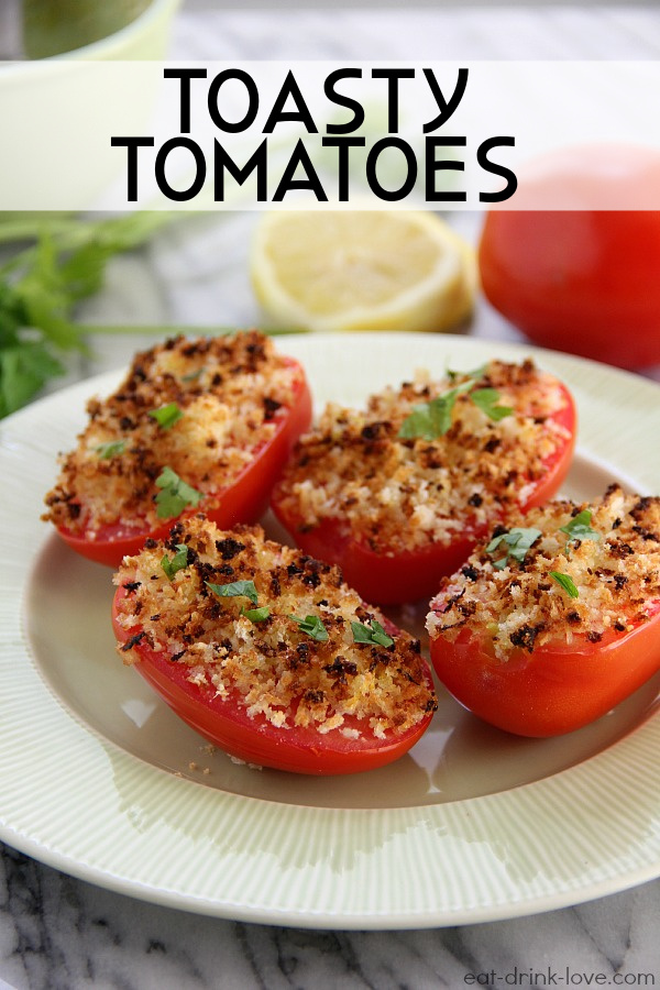 Toasty Tomatoes topped with breadcrumbs on a green plate