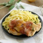 Lemon Chicken Saltimbocca on a plate with linguine