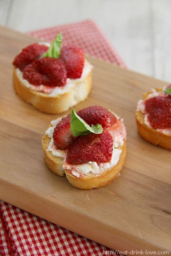 Roasted Balsamic Strawberry and Goat Cheese Crostini on a wooden board
