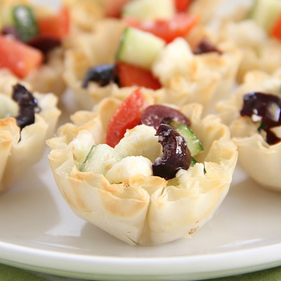 Greek Pastry Bites - diced cucumber, tomatoes, olives, and feta cheese served in mini puff pastry cups