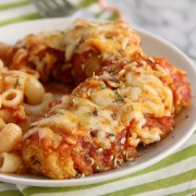 Easy Chicken Parmesan - strips of breaded chicken topped with sauce and cheese