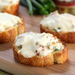 Cheesy Olive Toasts on serving board