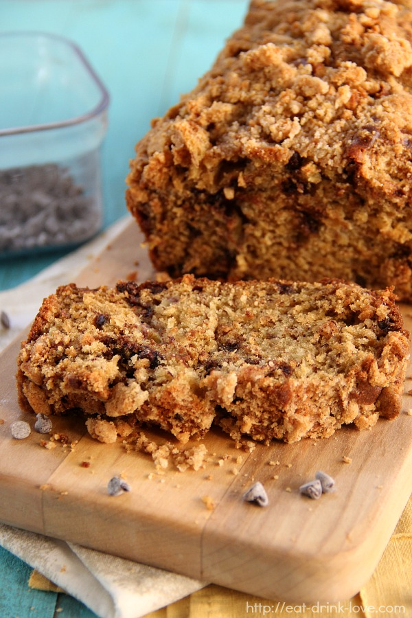 Chocolate Chip Banana Bread with Streusel Topping sliced on a wooden board