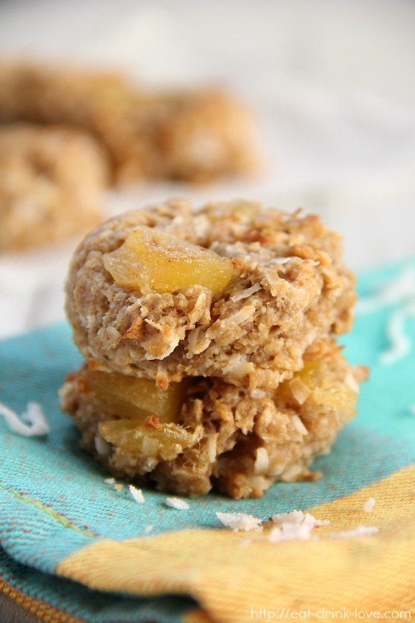Tropical Breakfast Cookies stacked with dried pineapple and mango on a teal napkin