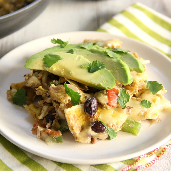 Southwestern Breakfast Scramble on a plate -scrambled eggs with peppers, onions, black beans, and avocado