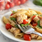 Chicken Caprese Pasta on plate with fork