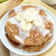 Whole Wheat Banana Pancakes with coconut syrup and banana slices