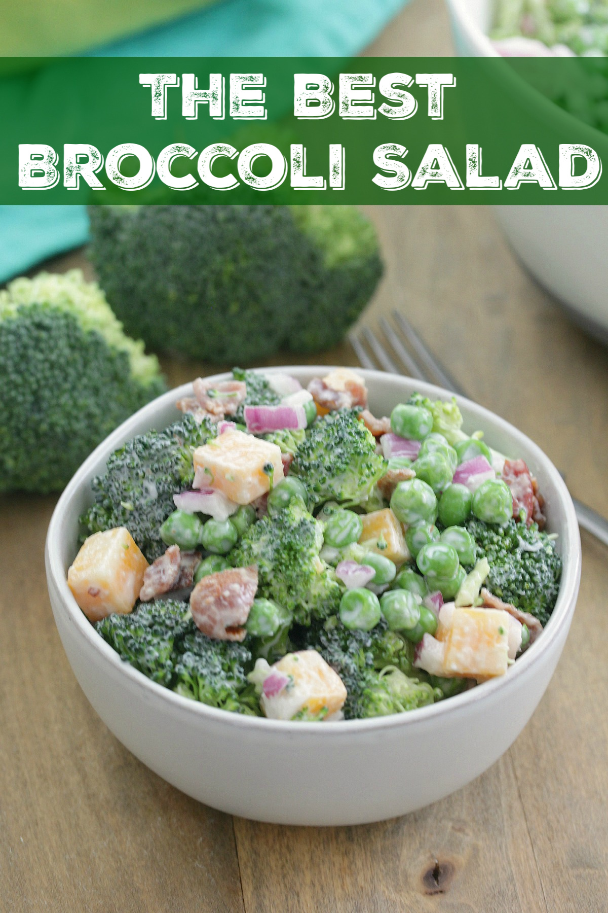 The Best Broccoli Salad - Fresh broccoli, peas, onions, cheese, and bacon tossed in a light tangy sauce!
