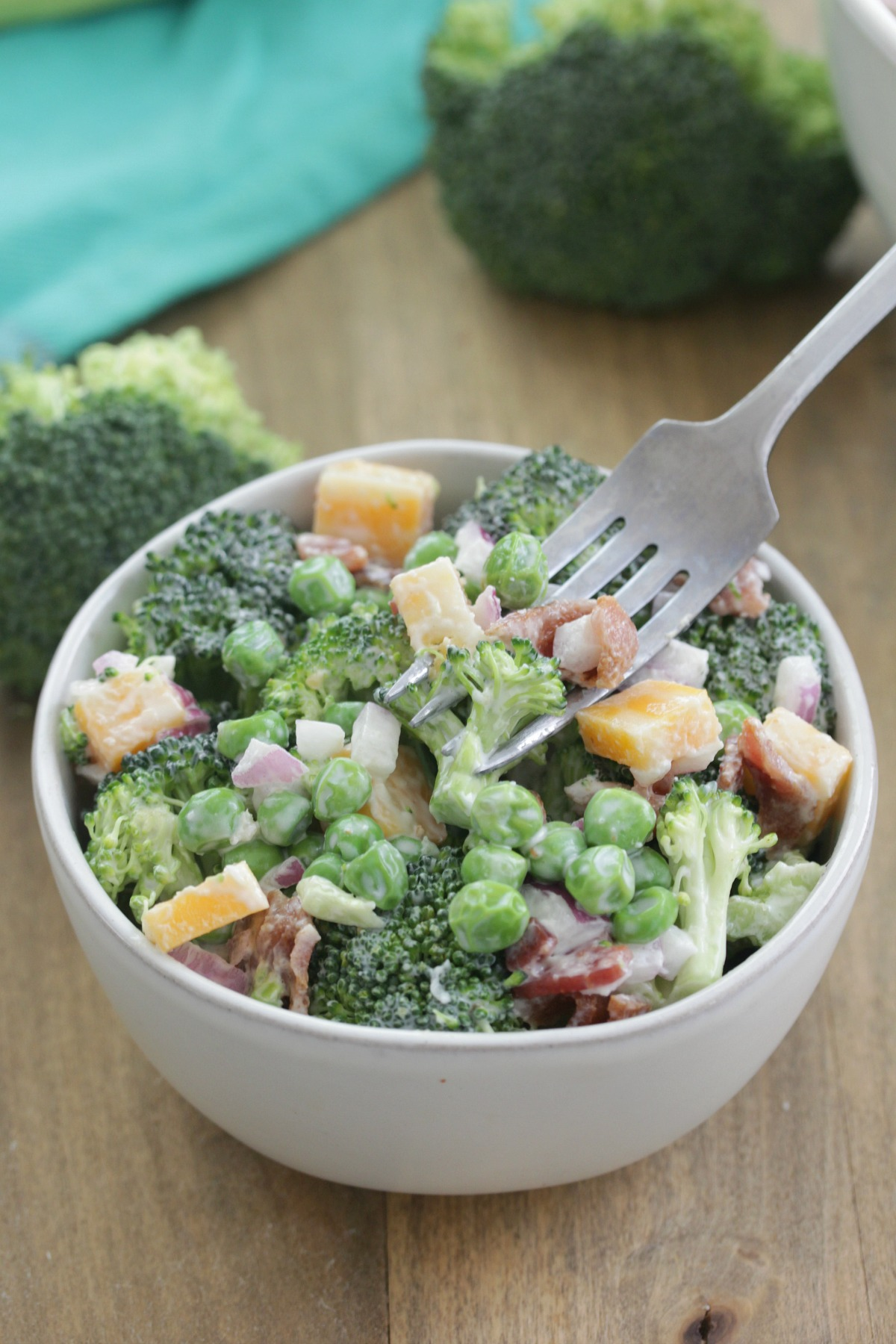 The Best Broccoli Salad - bowl of broccoli salad with bacon, cheese, and peas