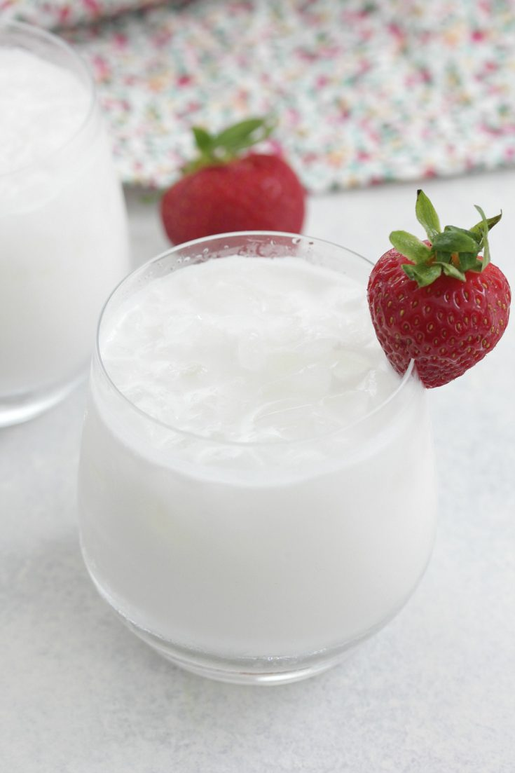 Coconut Coolers served in short glasses with sliced strawberries