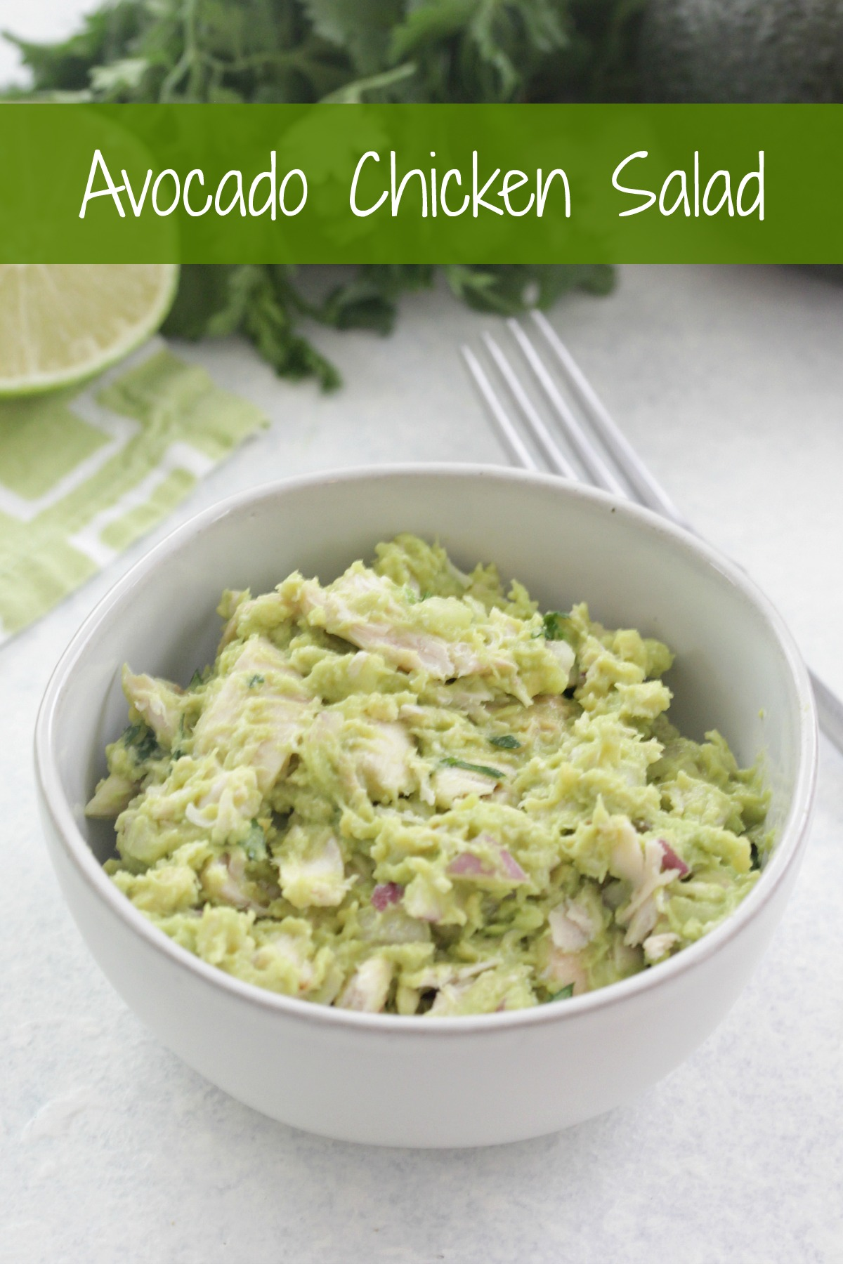 Avocado Chicken Salad in a white bowl with lime and cilantro