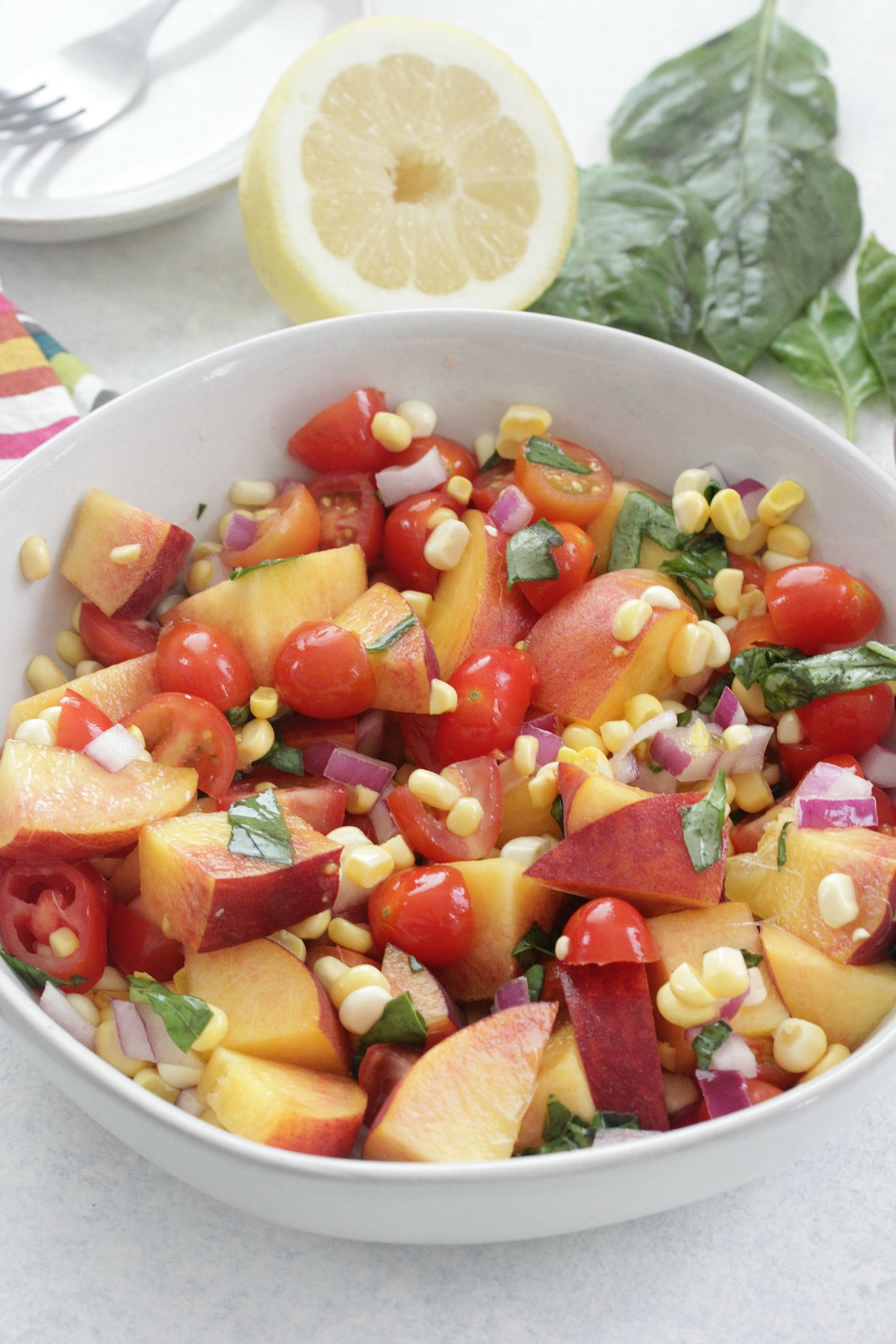 Peach and Tomato Salad in a large white bowl