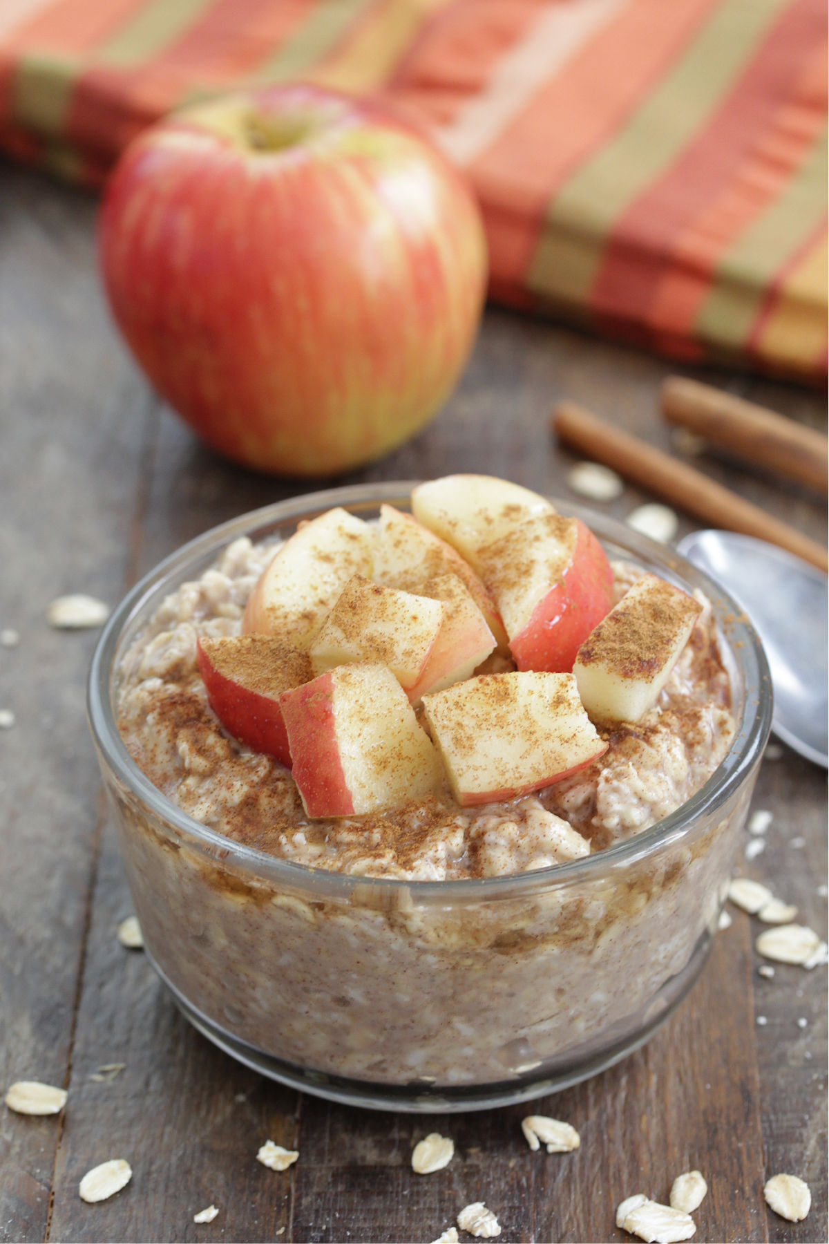 Apple Cinnamon Overnight Oats in a glass jar with diced apples and cinnamon on top