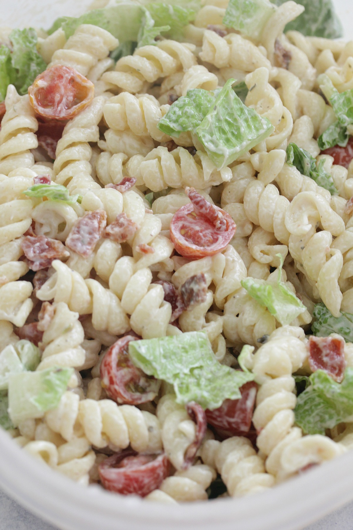 close up shot of BLT Pasta Salad in a clear container