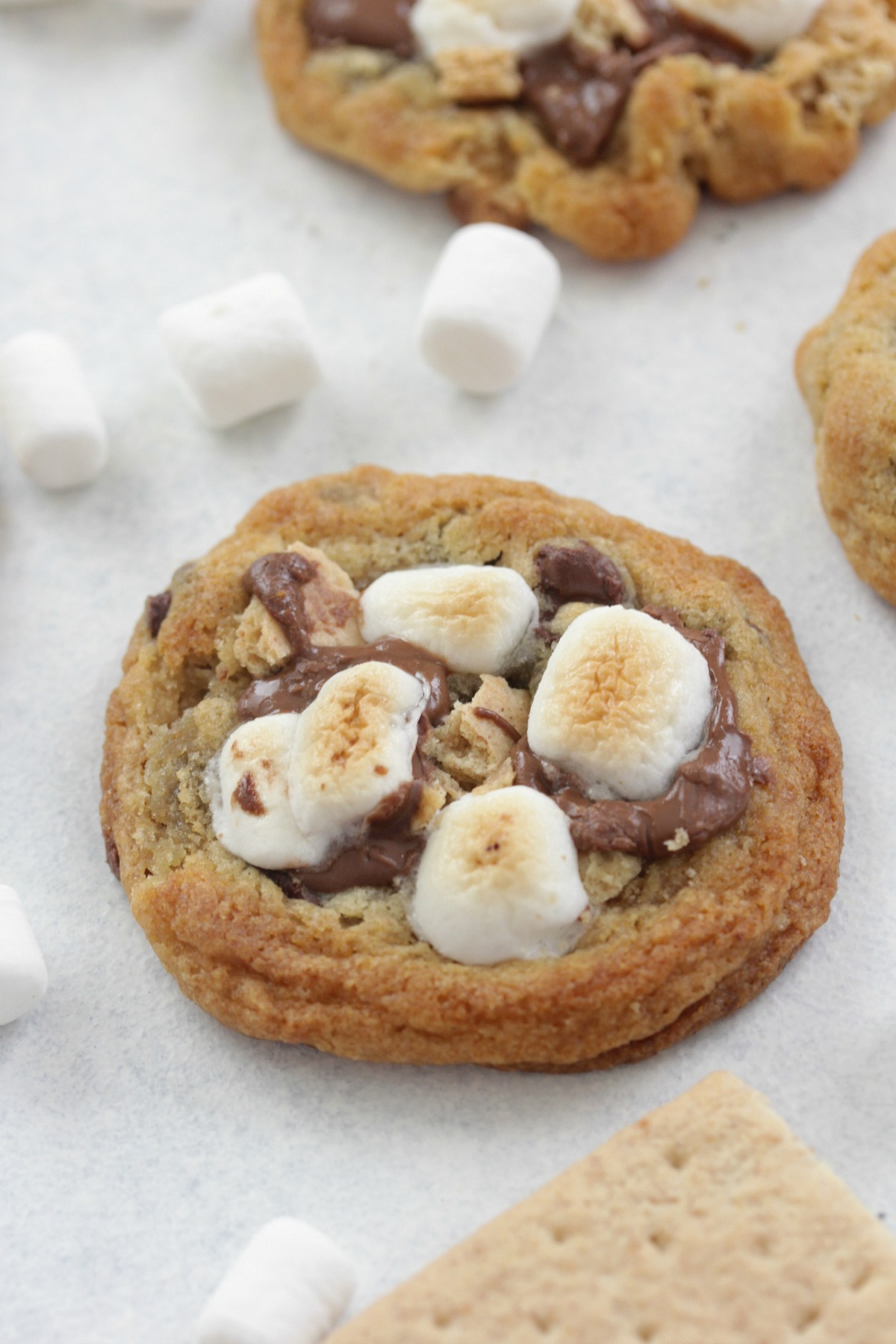 S'mores Cookies on a white board with mini marshmallows