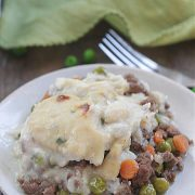 Low-Carb Shepard's Pie on a plate with cauliflower topping, beef, carrots, and peas