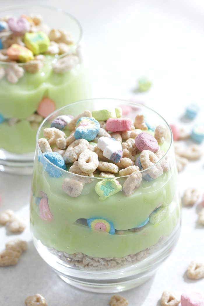 Lucky Charms Parfaits in a clear glass with green pudding and cereal on top