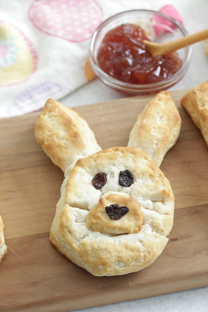 Bunny Biscuits on a wooden board with strawberry jelly