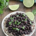 Instant Pot Black Beans on top of quinoa with fresh limes
