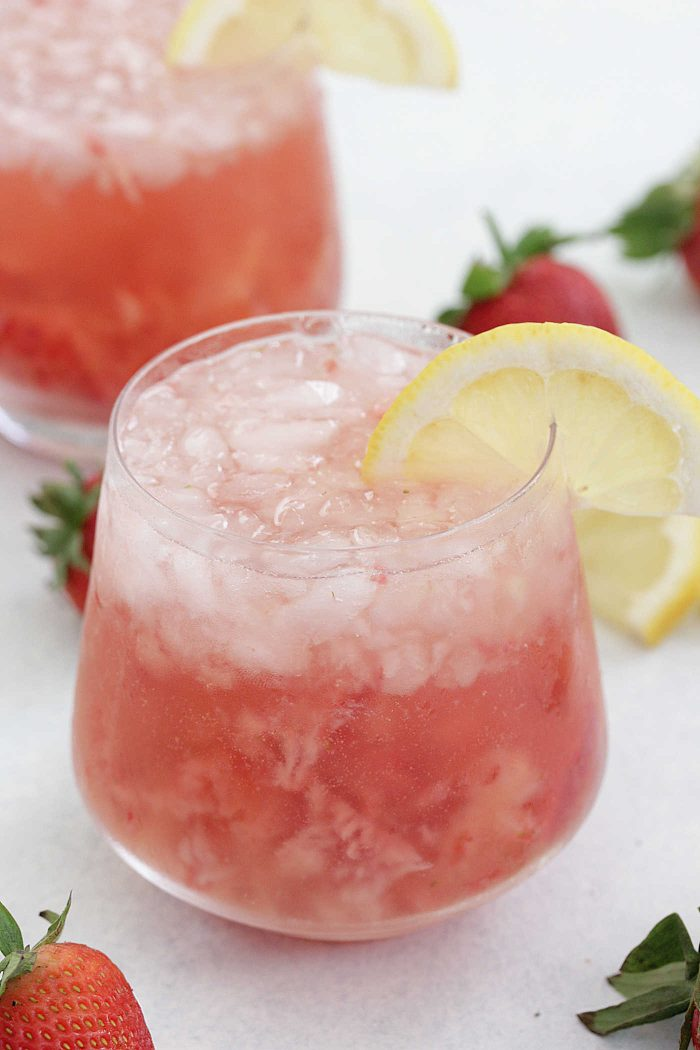 Strawberry Lemon Rosé in glasses with lemon slices and strawberries