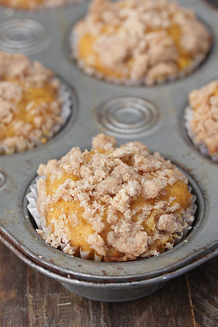 Apple Pumpkin Muffins in a muffin tin with crumb topping