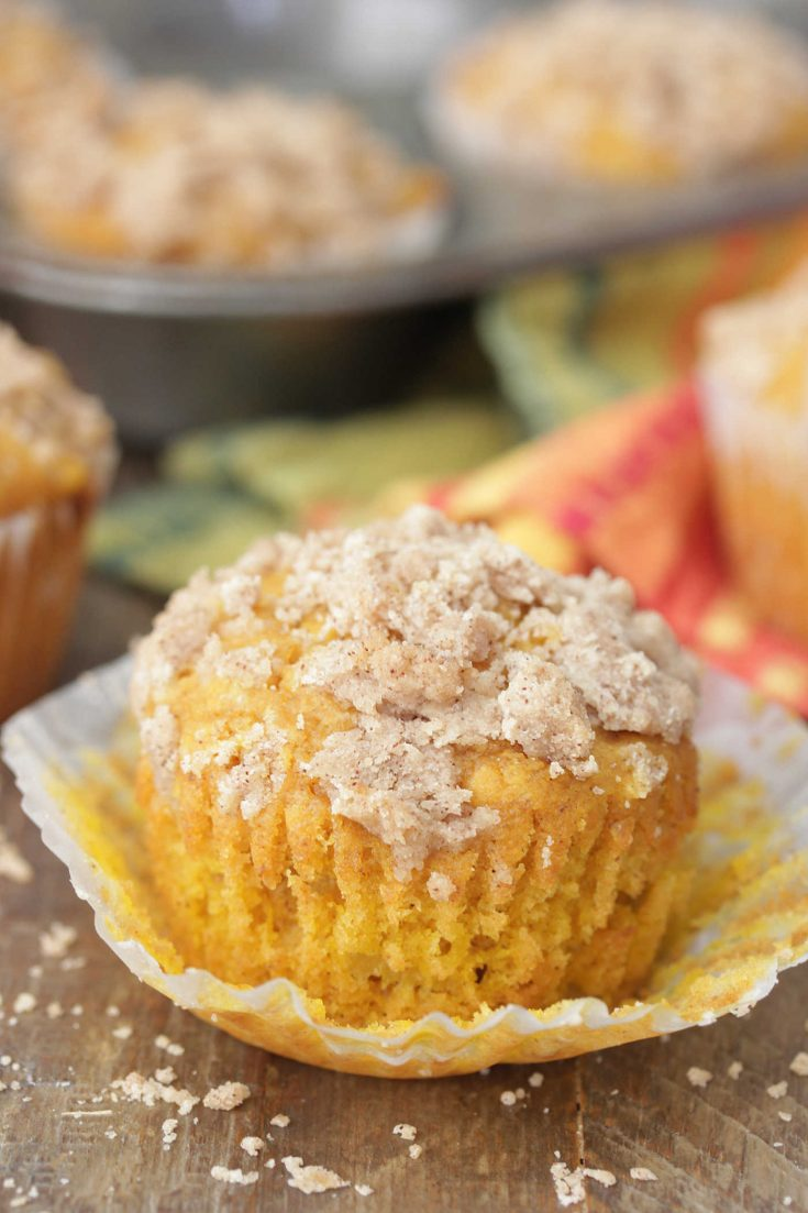 Apple Pumpkin Muffin on a peeled muffin wrapper with crumb topping