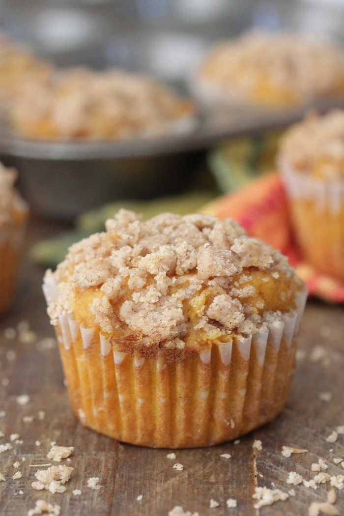 Apple Pumpkin Muffins on a dark wooden board