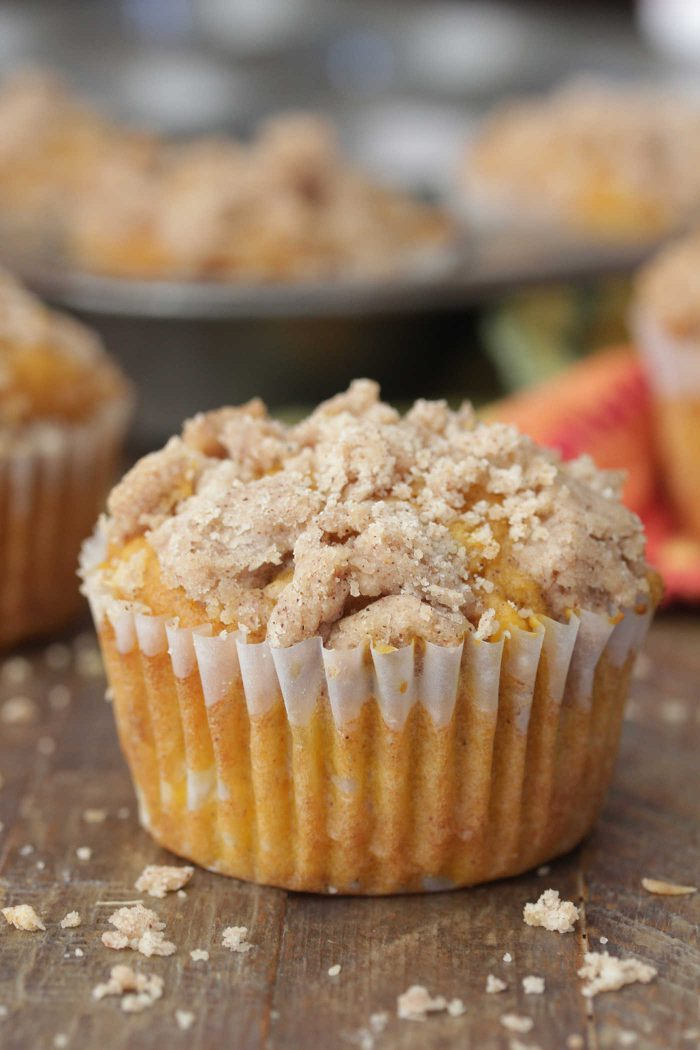Apple Pumpkin Muffins close up on a dark wooden board with crumb topping